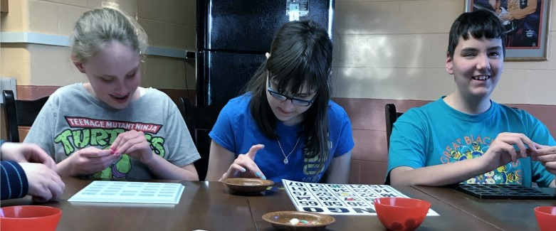 3 Children Playing Bingo