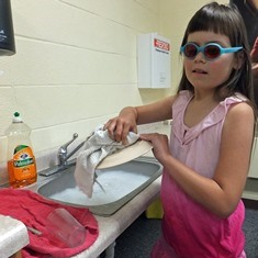 student washing dishes for independent living skills