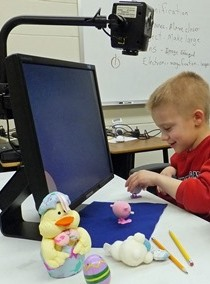 picture of a young student with low vision