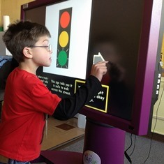 student using a touch screen tapit device